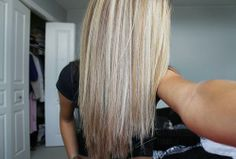 Straightened hair, platinum highlights with medium (ash) blonde lowlights