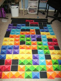 Tetris quilt - I think this just made the top of the to-do list! (After I finish all the others...). This'd be beautiful in Bali fabrics, more masculine than flowery prints.