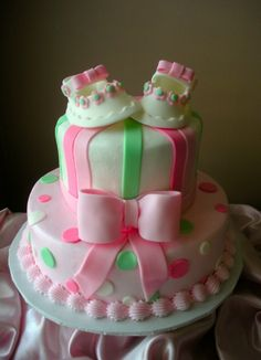 Pink and green baby shower cake with fondant baby shoes
