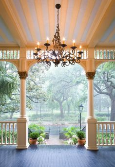 must have: front porch with chandelier
