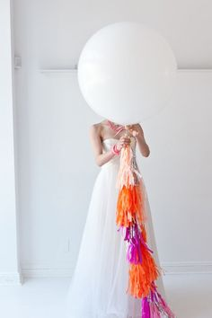 bride with geronimo balloon and neon tassels!  #wedding #decor ideas!!!  <3