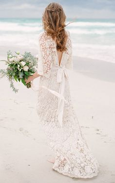 Beach wedding dress by Kite and Butterfly | Pin discovered by Kelly's Closet bridal boutique in Atlanta, Georgia