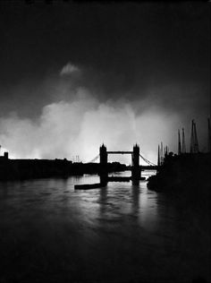 The Tower Bridge silhouetted against the fires on London's docks, ignited during a German air raid, 1940.   William Vandivert