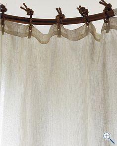 Eileen Fisher linen shower curtain...I just need a prettier rod to make this beautiful in my bathroom.