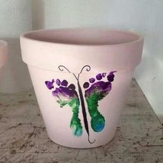 Butterfly footprint painted Mother's Day flower pot DIY art craft. by Nile Fair-Juul HOW SWEET!!!!