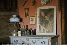 A chest-of-drawers, forgotten glass bottles and artwork are some of the items left behind in the old New Mexico depot town of Stein    Read more: http://www.dailymail.co.uk/news/article-2182753/Stagecoaches-outhouses-general-stores-Inside-preserved-American-ghost-town-left-untouched-70-years.html#ixzz22Ql0qa6Y