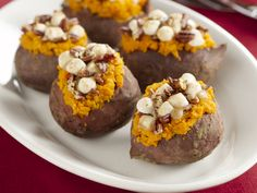 Stuffed Sweet Potatoes with Pecan and Marshmallow Streusel from FoodNetwork.com