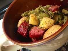 """ROASTED sausage potatoes and green beans! Line large baking dish with foil, preheat oven to 375 Layer sausage, diced potatoes and green beans add 1/8 cup olive oil over top, use McCormick """"chicken and potatoes"""" seasoning pack and mix all together, Bake for 90 minutes! Amaaaaazing! :)"""