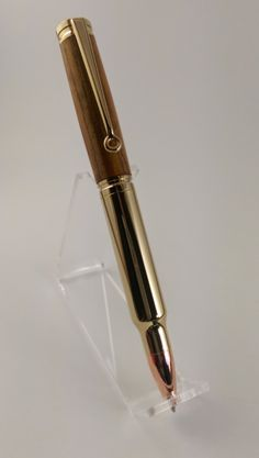 Gift for him - Valentines Day gift / Christmas gift / holiday gift or stocking stuffer for him - Magnum Bullet Cartridge twist pen- 24 kt gold - a bullet favored by sportsmen, game hunters and military snipers. Gun sight clip. A fancy pen for his office. Office Decor. Gift for the professional. Handmade and made in America. http://aftcra.com/pensbyderek/listing/5533/magnum-bullet-cartridge-twist-pen-24-kt-gold