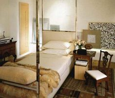 Room of the Day ~ bed in center of room with charming art, side chair and tables, fake fur and rug - Jeffrey Bilhuber and Tom Scheerer 9.21.2013
