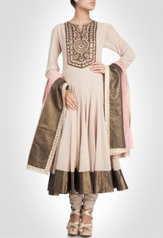Beige anarkali with richly crafted with stone, mirror work and embroidery. Shop Now: www.kimaya.in
