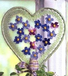 Bruges crochet ribbon on a heart frame with crocheted flowers