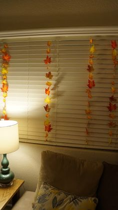 String these leaves along with white Christmas lights in the dorm