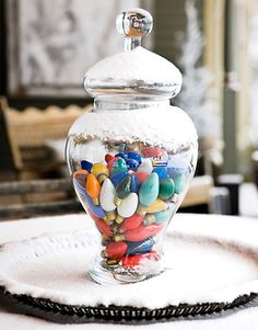 antique Christmas lights in apothecary jar.