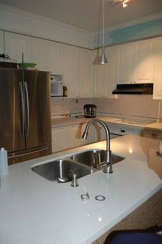 My DIY painted oak kitchen cabinets with brand new white quartz counters.