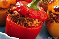 This Slow Cooker Stuffed Peppers recipe is loaded with healthy ingredients, like corn kernels, black beans, ground turkey, and brown rice.  And it is only 227 calories per serving!  #stuffedpeppers #recipe #skinnyms
