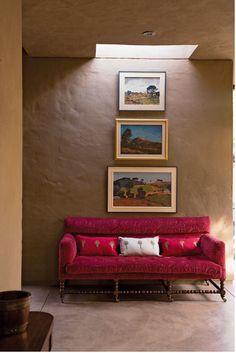 pink sofa and nice natural light over artwork