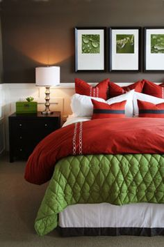 contemporary master bedroom decor combines warm reds and greens colors for bedding with cool brown and white walls