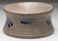 """Estimated Price: $100 - $150Description: STAMPED """"WM. MOYER / HARRISBURG PA."""" PENNSYLVANIA DECORATED STONEWARE SPITTOON, salt glazed, the stamp flanked with brushed cobalt feather decoration, additional cobalt across part of stamp.Condition: Moderate chip to rim near back, otherwise excellent.Provenance: From a Page Co., VA collection.Dimensions: 4"""" H, 8"""" D.Circa: Circa 1858-1860."""