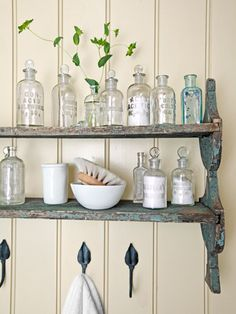 A weathered shelving unit provides a perfect perch for lotions and other bathroom accessories.