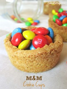 M&M Cookie cups - all you need is your favorite cookie cups recipe and a package of m&m's.