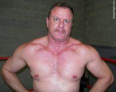 a hot hunky blue eyes eyed wrestler moustache man