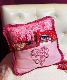 Free project instructions to make a fleece pocket pillow. This would be a great idea for a throw pillow for a bed. Could keep the book you're reading in the pocket.