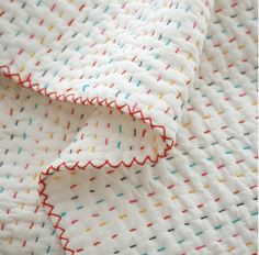 Hand stitched quilt, multicolored embroidery, by Citta Design as seen at Hermit Homewares