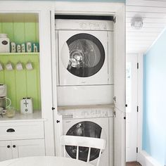 Tall pantry-style cabinets conceal a stackable washer and dryer in a small-space kitchen. When every inch counts, that's a seriously smart use of space.