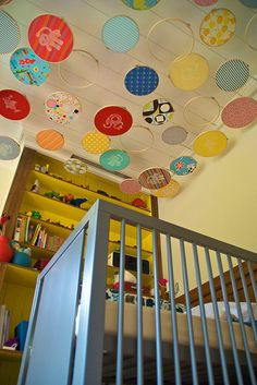 Embroidery hoops on the ceiling! Too cute.