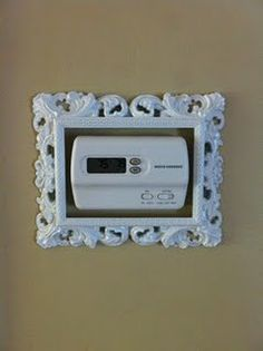 Picture frame over AC controls.