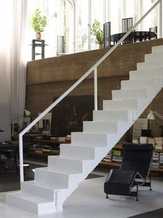 A well-loved LC4 under those great stairs; Mackintosh Gateleg table in the loft. / The Factory / Ricardo Bofill