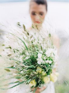 wild bouquet of see grasses and pale yellow flowers