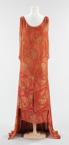 """Circa 1929 silk Evening Dress, Bergdorf Goodman (American, founded 1899): """"Beginning in 1914, Bergdorf Goodman began to introduce ready-to-wear, making it the destination for leading American and French fashions. This dress, complete with an early Bergdorf label, is special for its visual appeal. The design of the front of the dress is quite different from the back, showing the transition from the tubular silhouette of the 1920s to the more fluid silhouette of the 1930s."""""""