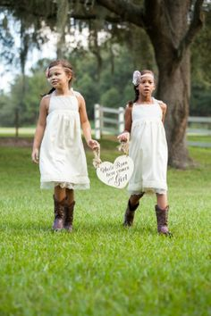 Rustic flower girls in simple lace dress and cowboy boots from our rustic themed fall wedding.  Copyright - Jerdan Photography