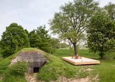 Concrete bunker in the Netherlands transformed into a tiny vacation home.