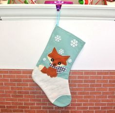 Fox Christmas Stocking in Aqua Blue by by AllenbriteStudio on Etsy, $25.00