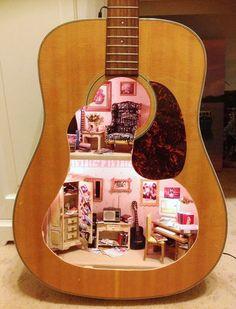 dollhouse in a guitar.