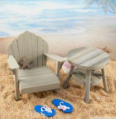 Mini adirondack chair and table on the fairy garden beach.