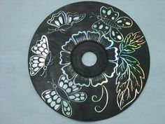 Turn old CDs into works of art with acrylic paint and scratching away the design.