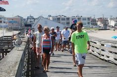 Visitors walked out on the Ocean City Fishing Club's pier during the first of three open houses held last year to celebrate the club's 100th anniversary.