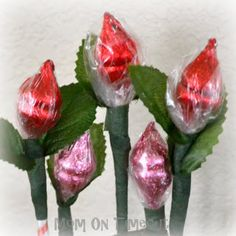 Hershey's Kiss Roses - A Sweet Valentine's Day Bouquet    Or use colored celophane