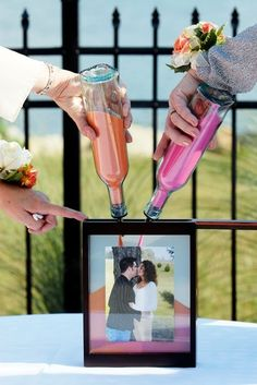unity sand instead of a candle, but this is so cool--shadowbox instead of a jar!!! then you can put your favorite picture on the front, use your wedding colors for the sand...and you always have a cute keepsake from your wedding day =)