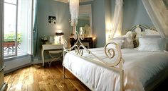 I love this look of this bedroom. It has a French nod, but is not over the top. The taste level is spot on.