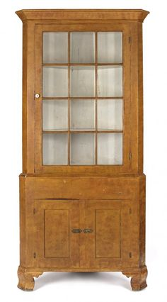 Sold $3,000 Pennsylvania painted poplar two-part corner cupboard, ca. 1830, retaining an old yellow and red decorated surface, 84 1/2'' h., 38 1/2'' w.