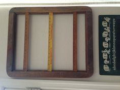 Art work frame with vintage rulers for my kids art