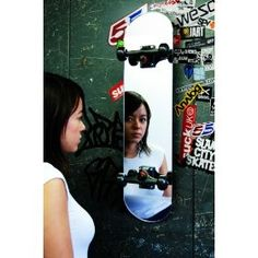Give your room some style by adding some skater decor with this Skateboard Mirror made from stainless steel, glass, and real skateboard parts. This skateboard mirror can be hung either horizontally or vertically, and makes a great addition to any skater's bedroom.