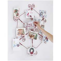 Easy Christmas crafts: Display holiday cards on this whimsical wire holder.