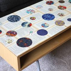 DIY steps to turn any boring coffee table into a beautiful work of art - using old book pages and washi paper scraps.