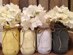 Painted Mason Jars in grays and yellows.